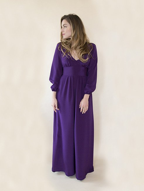 Woman wearing the Alix Dress sewing pattern from By Hand London. A maxi dress pattern made in cotton lawn, voile, chambray, double gauze, silks, crêpes or rayon fabrics, featuring a high waist, V-neck yoke, inset waistband, full skirt, billowing raglan sleeves with elasticated cuff.