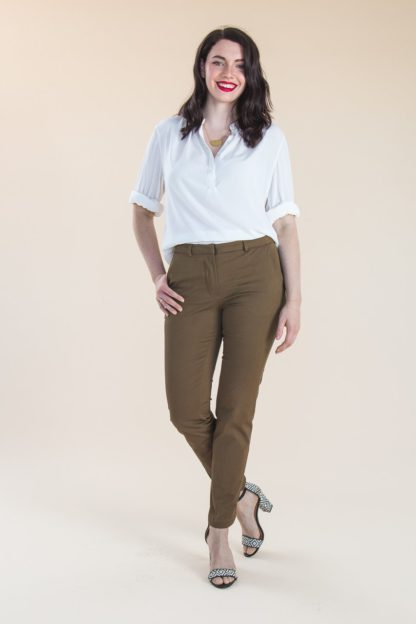 Woman wearing the Sasha Trousers sewing pattern by Closet Core Patterns. A trouser pattern made in stretch denim, twill, suiting or gabardine fabric featuring a flattering mid-rise, contour waistband, slim tapered legs and slashed hip pockets.
