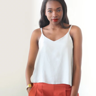 Woman wearing the Ogden Cami sewing pattern by True Bias. A camisole pattern made in crepe, rayon challis, voile or lightweight linen fabric featuring a soft V-neck at both centre front and centre back and delicate spaghetti straps.