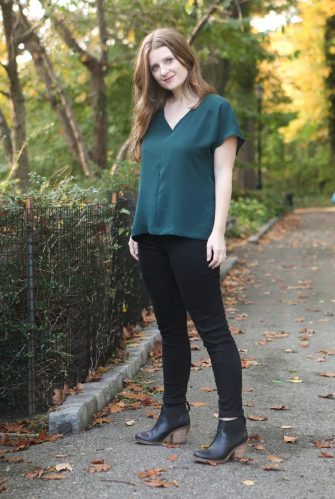 Woman wearing the Sutton Blouse sewing pattern by True Bias. A loose fitting V-neck top pattern made in rayon challis, crepe, silk or lightweight linen fabric featuring grown on sleeves, a one-piece yoke and a back inverted pleat.
