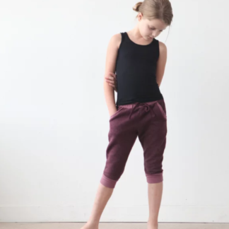 Girl wearing the Mini Hudson Pant sewing pattern by True Bias. A skinny sweatpant pattern made in cotton lycra, French terry, ponte or sweatshirt knit fabric featuring an elastic waistband with drawstring, pockets and cuffs.