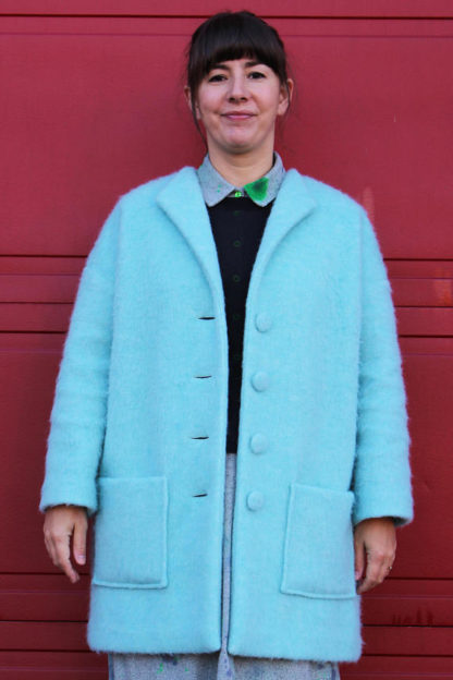 Women wearing the Honetone Coat sewing pattern from Marilla Walker on The Fold Line. A coat pattern made in coating wool fabrics, featuring a straight cut, thigh length hem, grown on sleeves, front patch pockets and button front fastening.