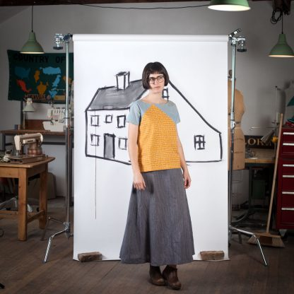 Woman wearing the Saltbox Tee sewing pattern by Blue Prints for Sewing. A T-shirt pattern made in quilting cotton, chambray, linen blends, rayon challis, voile, lawn, double gauze, crepe de chine or charmeuse fabrics, featuring a short sleeves, boat neck and side vents at the hem.