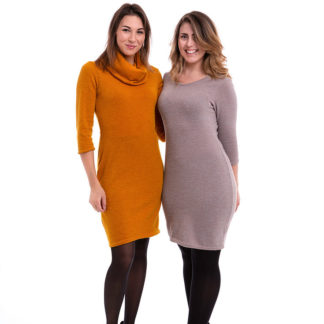 Women wearing The Tara Basic sewing pattern from Pipe Dream Patterns on The Fold Line. A dress pattern made in jersey weight, knits, pontes, stretch velvets or elastane/Lycra blend fabrics, featuring a figure hugging silhouette, ¾ length sleeves, knee length finish and either scoop neck or high rolled collared neckline.