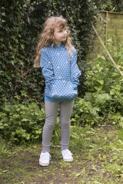 Child wearing the Baby/Child Frances Leggings sewing pattern by Bobbins and Buttons. A leggings pattern made in medium weight jersey fabrics, featuring an elasticated waist, snug fit and cuffed hems.