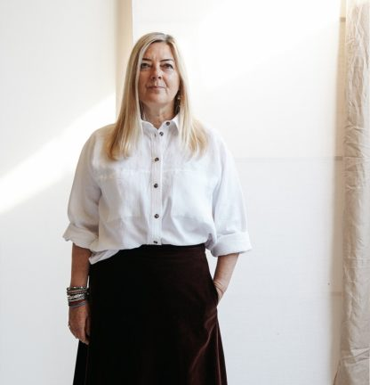 Women wearing the Olya Shirt and Dress sewing pattern from Paper Theory Patterns on The Fold Line. A shirt pattern made in crepe de chine, viscose, georgette, corduroy, drill and light weight denim fabrics, featuring a loose fit, two piece stand and collar, front button placket, back yoke with box pleat, barrel cuffs with a tailored placket and double pleat at the wrist and two breast pockets.