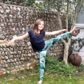 Child wearing the Children's Moov Leggings sewing pattern by Dhurata Davies Patterns. A leggings pattern made in light to medium weight jersey fabric with at least 30% stretch and good recovery, featuring an elasticated waist and snug but comfortable fit.