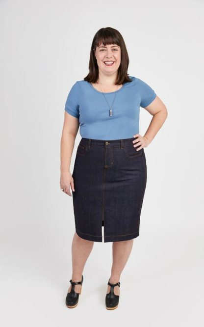 Woman wearing the Ellis Skirt sewing pattern by Cashmerette. A skirt pattern made in denim, corduroy or canvas fabric featuring a knee length hem, front slit, 5 pockets, front fly closure and top stitching.