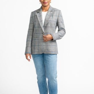 Woman wearing the Jasika Jacket sewing pattern by Closet Core Patterns. A classic tailored jacket pattern made in wool melton, wool flannel, crepe or tweed featuring a semi fitted shape, fully lined, back vent, shoulder pads and welt pockets.