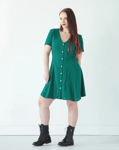Woman wearing the Shelby Dress sewing pattern by True Bias. A dress pattern made in rayon challis, crepe, silk or linen fabric featuring princess seams, front button fastening, short sleeves and a V-shaped neckline.