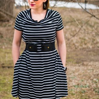 Woman wearing the Camilla Cowl Neck Dress sewing pattern by 5 out of 4 Patterns. A knit dress pattern made in knit fabrics with at least 50% stretch, featuring a cowl neck, short sleeves, in-seam pockets and above knee length.