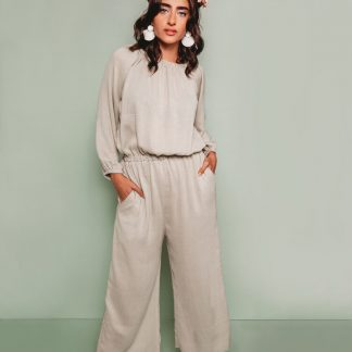 Women wearing the Avenir Jumpsuit sewing pattern by The Assembly Line. A jumpsuit pattern made in knit or woven fabrics featuring billowy sleeves and wide legs, elastic gathers at the neck, wrist and waist.