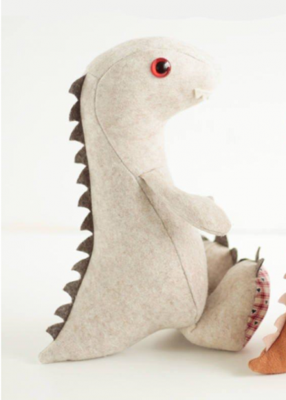 Dinosaur shaped toy, the Baby Dinosaur Soft Toy sewing pattern by Crafty Kooka. A soft toy pattern made in wool felt, cotton, linen, plush or minky fabrics.