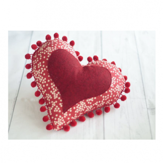 Heart shaped toy, the Heart Pin Cushion sewing pattern by Crafty Kooka. A soft craft pattern made in cotton fabric with wool felt for applique.