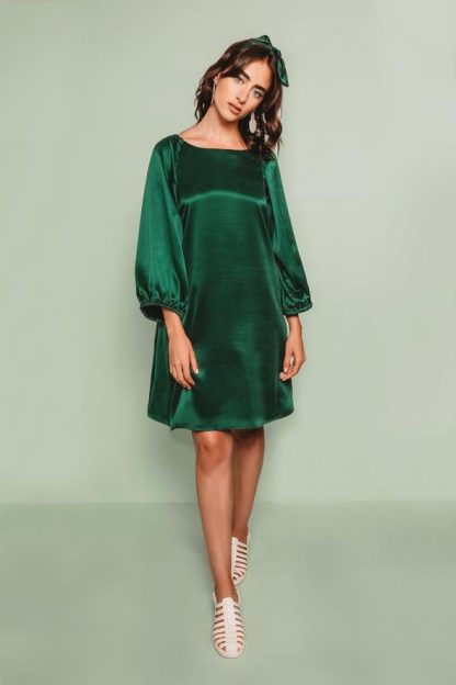 Woman wearing the Adrianna Dress sewing pattern by Friday Pattern Company. An A-line, pull on, dress pattern made in silk, rayon, linen or cotton fabric featuring large statement sleeves and high neckline.