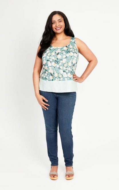 Woman wearing the Springfield Top sewing pattern by Cashmerette. A sleeveless top pattern made in cotton lawn, Linen, chambray, or crepe fabric featuring a scooped neckline, back yokes and split side seams.