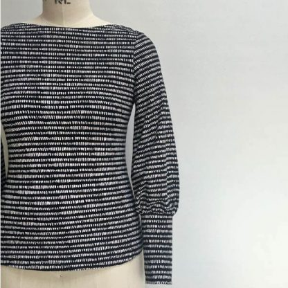 Mannequin wearing the Somerset T-shirt sewing pattern from Maven Patterns on The Fold Line. A T-shirt pattern made in light to medium weight knit fabrics, featuring a slim fitting silhouette, bateau neckline and bishop sleeves with deep cuffs.