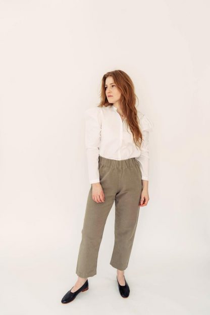 Woman wearing the Pomona Pants sewing pattern by Anna Allen. A trouser and shorts pattern made in cotton canvas, twill, medium to heavy weight linen or wool suiting fabrics, featuring an elastic waist, high rise, loose fit and patch pockets.