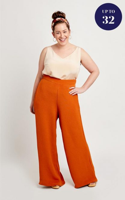 Woman wearing the Calder Trousers sewing pattern by Cashmerette. A trouser pattern made in light to mid weight wovens such as rayon, tencel, linen or chambray fabric featuring a wide leg, flat front, elasticated back waistband and in seam pockets.