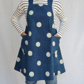Women wearing the Maria Wrap Apron sewing pattern from Maven Patterns on The Fold Line. An apron pattern made in denims, chambrays or linen fabrics, featuring a wrap style back, cross over straps and two large patch pockets.