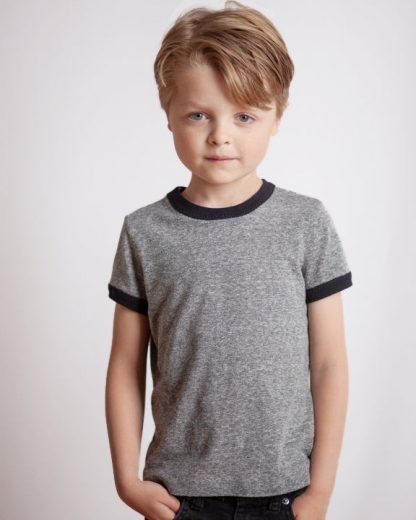 Boy wearing the Children's Mini Rio Ringer T-shirt sewing pattern by True Bias. A T-shirt pattern made in cotton interlock or T-shirt jersey fabric featuring contrasting ribbing around the crew neckline and short sleeves.