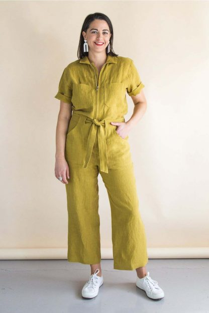 Woman wearing the Blanca Flight Suit sewing pattern by Closet Core Patterns. A semi fitted boiler suit pattern made in denim, twill, linen or cotton fabric featuring a centre front zip, patch pockets, tie belt and traditional shirt collar.