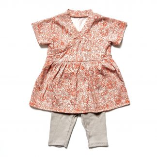 The Babies' Flo Dress and Riley Leggings sewing pattern by Dhurata Davies Patterns. A dress and leggings pattern made in lightweight cotton jersey fabric, featuring a short sleeved, V-neck dress and leggings with an elasticated waist.