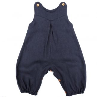 The Babies' Penny Romper sewing pattern by Dhurata Davies Patterns. A romper pattern made in light to medium weight woven fabric, featuring snap fasteners on the shoulders and leg inseam, a front V shaped yoke, inverted front pleat detail, all-in-one sleeve and elasticated hems.