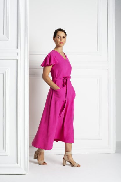 Woman wearing the Margot Dress sewing pattern from Pattern Sewciety on The Fold Line. A dress pattern made in cotton, cotton blends, linen, linen blends, rayon's or satin fabrics, featuring a relaxed fit, V-neck, bust darts, waist seam, short circle sleeves, invisible back zipper and tie belt.