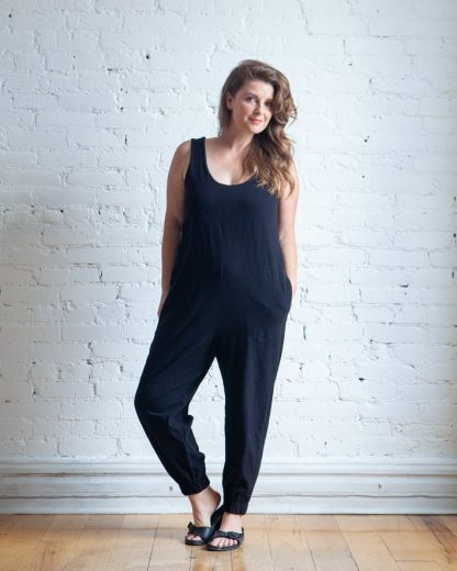 Woman wearing the Nova Jumpsuit sewing pattern by True Bias. A sleeveless jumpsuit pattern made in cotton interlock or T-shirt jersey fabric featuring a low scooped neckline, inseam pockets and a relaxed fit.
