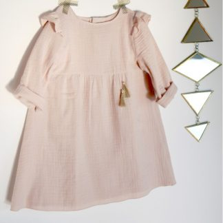 The Bouton d'Or Dress sewing pattern by Atelier Scammit. A dress pattern made in batiste, double gauze or jersey fabrics, featuring shoulder yokes and sleeve caps, in long sleeves, back button closure and gathered skirt.