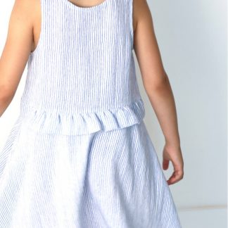 Child wearing the Baby/Child Petite Lune Dress sewing pattern by Atelier Scammit. A sleeveless dress pattern made in light to medium batiste, double gauze and light denim fabrics, featuring a full circle skirt and scooped necklines.