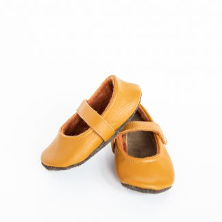 The Babies' Natty Janes Shoes sewing pattern by Delia Creates. A baby shoe pattern made in faux leather/pleather, marine vinyl, thick wool felt or leather for the uppers and leather/faux leather for the sole, featuring a soft upper and adjustable strap.