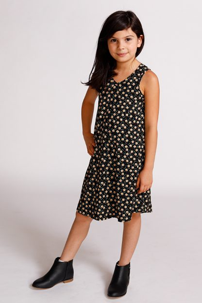 Child wearing the Baby/Child Mini Pony Dress sewing pattern by Chalk and Notch. A tank dress pattern made in light to medium weight 75% – 100% stretch knit fabrics, featuring an A-line silhouette, V-neckline and curved hem.