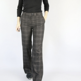 Woman wearing the Allure Trousers sewing pattern by Atelier Scammit. A trouser pattern made in denim, tweed, velvet or flannel fabrics, featuring a straight leg, mid-rise and Italian pockets.