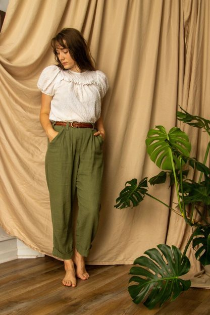 Woman wearing the Chandler Trouser sewing pattern from Untitled Thoughts on The Fold Line. A trouser pattern made in linen, rayon challis, crepe, lawn, silk charmeuse, chambray, tropical weight wool or cotton poplin fabrics, featuring a relaxed fit, elastic back waistband, pleated front, slash pockets, faux fly and belt loops.
