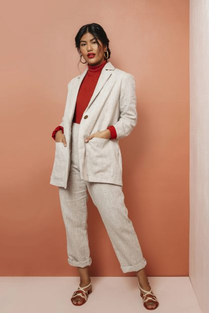 Woman wearing the Heather Blazer sewing pattern by Friday Pattern Company. A blazer pattern made in linen, suiting, twill, denim or canvas fabric featuring a slightly oversized fit, single button closure, front patch pockets and lapel collar.
