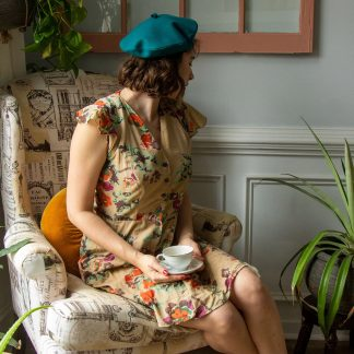 Woman wearing the Bijou Beret sewing pattern by Untitled Thoughts on The Fold Line. A hat pattern made in wool, velvet, satin or suede, featuring a soft round silhouette with a flat crown.