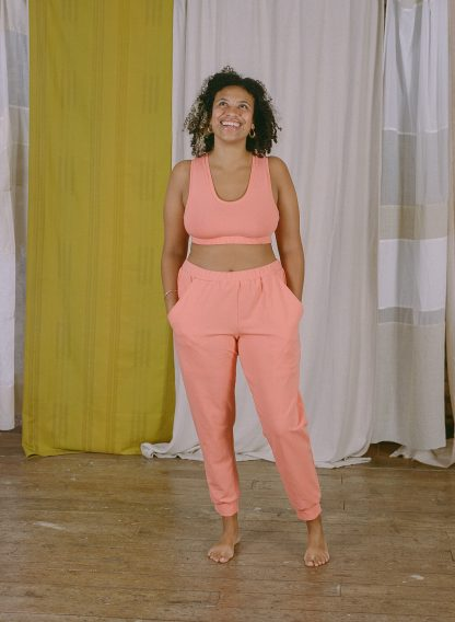 Woman wearing the Lottie Top and Bra sewing pattern from Made My Wardrobe on The Fold Line. A bra or top pattern made in medium weight knit fabrics, featuring a racerback shape that can be made full length or as a bra with an elasticated underband.