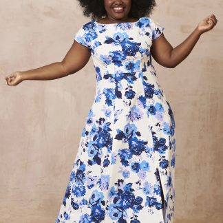 Woman wearing the Anna Dress sewing pattern from By Hand London. A maxi dress pattern made in rayon, silks, chiffon, wool crepe, quilting cotton, lawn, batiste, shirting or voile fabrics, featuring double pleats at the bust, grown-on sleeves, panelled A-line skirt and slash neck.