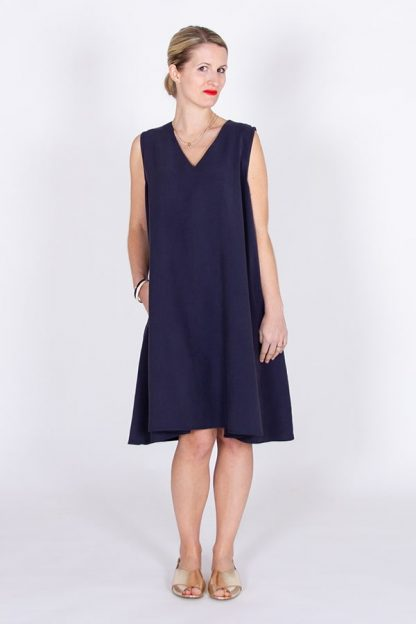 Woman wearing the Cinderella Dress sewing pattern by I AM Patterns. A sleeveless dress pattern made in viscose, washed linen, chambray, lightweight denim, poplin, viscose crepe or silk fabric, featuring a V-neckline, in-seam pockets and a very loose fit.