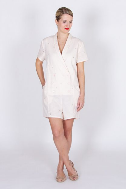 Woman wearing the Diana Playsuit sewing pattern by I AM Patterns. A playsuit pattern made in crepe, Tencel, linen, chambray, cotton, viscose twill or lightweight denim fabrics, featuring short sleeves, shawl collar, in-seam pockets and front button closure.