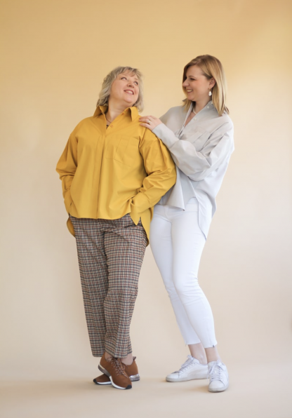 Women wearing the Misha Shirt sewing pattern by Lenaline Patterns. An oversized shirt pattern made in cotton's, linen, tencel, chino or flannel fabrics, featuring long sleeves, with pleats at the top and bottom, ending in wide cuffs, shirt collar, hidden button placket and pleated front patch pocket.