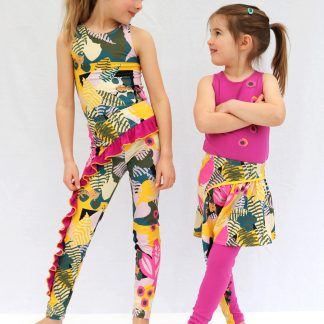 Children wearing the Children's Skruffle Leggings sewing pattern by The Sewn Edge. A leggings pattern made in medium weight knit fabrics with 40% four-way stretch and good stretch recovery, featuring a classic legging with either a playful frill or a part skirt part ruffle frill.