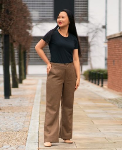 Woman wearing the Upland Trousers sewing pattern by Itch to Stitch. A trouser pattern made in linen, linen mix, twill, corduroy, suiting or poplin fabrics, featuring a high rise, no waistband, fitted through the waist and hip and relaxed at the thighs and below plus front and back pockets.