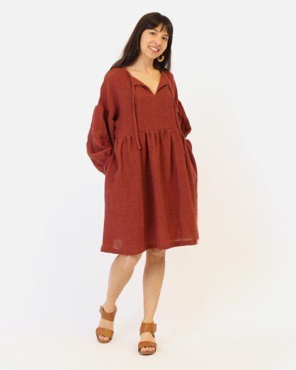 Woman wearing the March Dress sewing pattern by Helens Closet. A dress pattern made in light to medium weight woven fabrics with no stretch, featuring a relaxed fit, voluminous long sleeves, gathered skirt, and a neck tie that you can tie in the front or leave to hang open to create a V-neck.