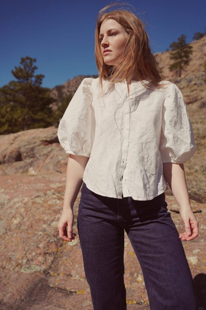 Women wearing the Anthea Blouse sewing pattern by Anna Allen. A blouse pattern made in cotton, linen, voiles, lawns or silk fabrics, featuring elbow length puffed sleeves, relaxed fit, button front closure with a fold-over placket and bias faced neckline.