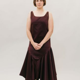 Woman wearing the 264 Monte Carlo Dress sewing pattern from Folkwear on The Fold Line. A sleeveless, flapper styled, sheath dress pattern made in lightweight and/or sheer silk, rayon, polyester, novelty velvets and jacquard fabrics, featuring straight sides, dropped waist, handkerchief hem and square neckline.