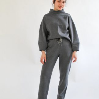 Woman wearing the Apollo Jumper sewing pattern from Bella Loves Patterns on The Fold Line. A jumper pattern made in heavy and medium weight knit fabrics, featuring an oversized fit, drop shoulders, high funnel neck, bracelet length sleeves with tapered cuffs.