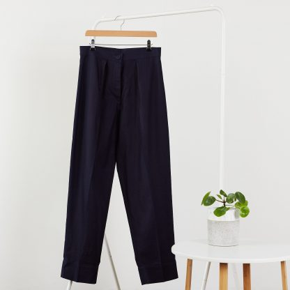 The Bogan Trousers sewing pattern from PH7 Patterns on The Fold Line. A trouser pattern made in cotton and cotton mix, linen and linen mix fabrics, featuring a button and zip fly closure, mid-rise waist band, front pleats and tapered leg.